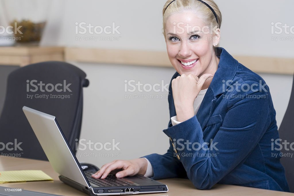 Beautiful Blond Businesswoman Using Laptop in Conference Room, Copy Space royalty-free stock photo
