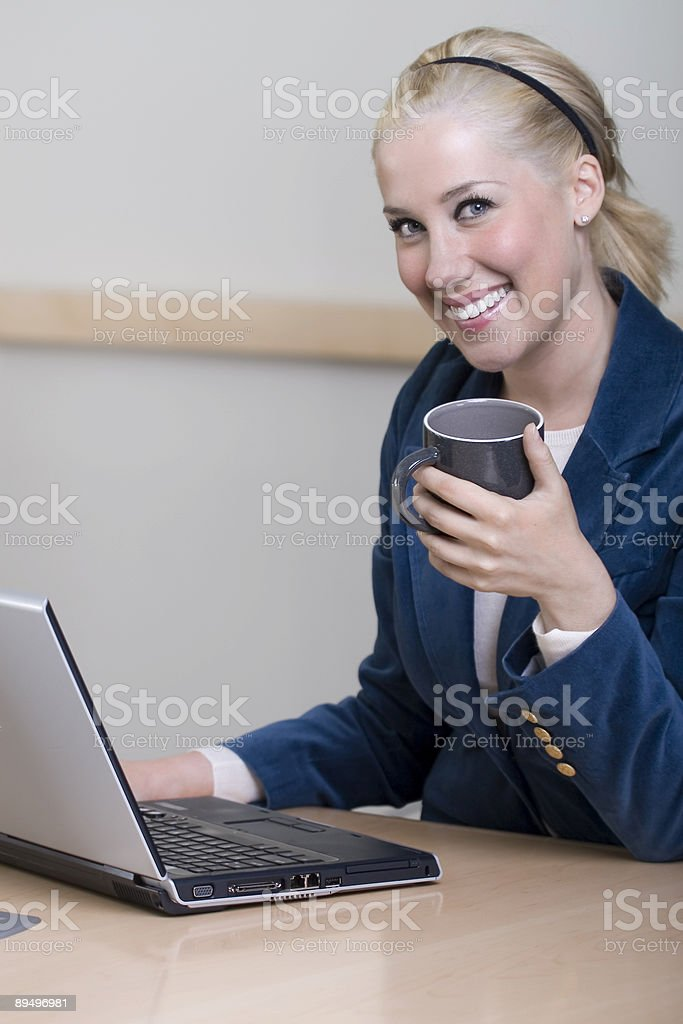 Beautiful Blond Businesswoman Using Laptop in Meeting Room, Copy Space royalty-free stock photo