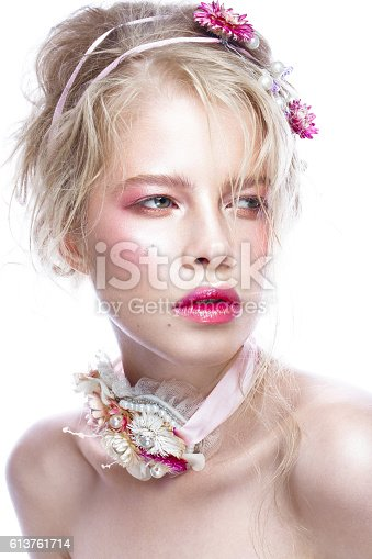 istock Beautiful blond fashion girl with flowers on neck and in 613761714