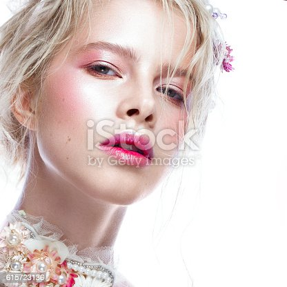 istock Beautiful blond fashion girl with flowers on neck and in 615723136