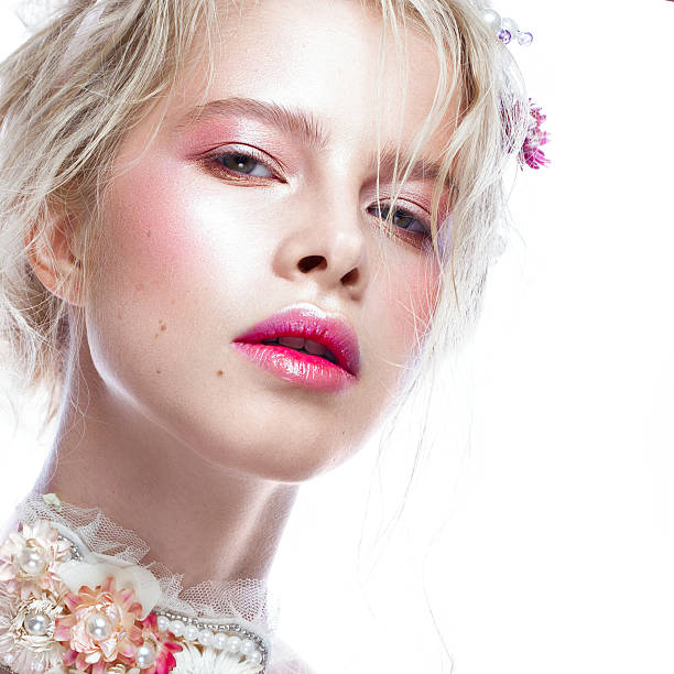 Beautiful blond fashion girl with flowers on neck and in Beautiful blond fashion girl with flowers on the neck and in her hair, wet Nude makeup. Beauty face. Photos shot in the studio. nude women pics stock pictures, royalty-free photos & images