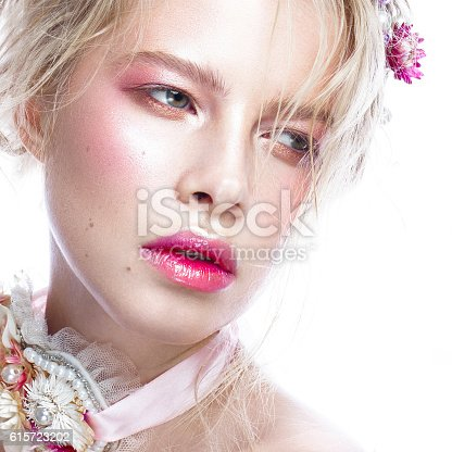 istock Beautiful blond fashion girl with flowers on neck and in 615723202