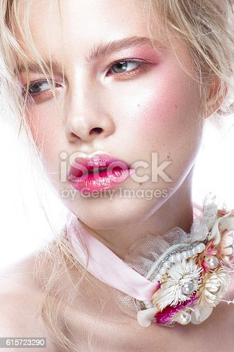 istock Beautiful blond fashion girl with flowers on neck and in 615723290