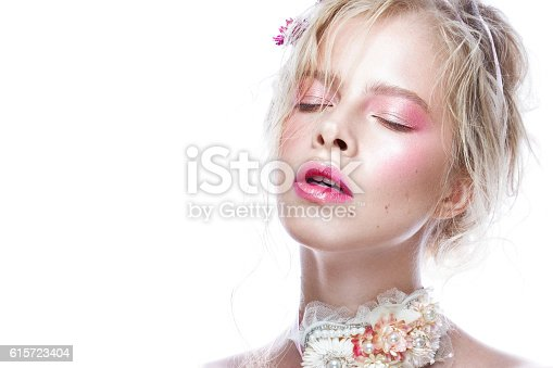 istock Beautiful blond fashion girl with flowers on neck and in 615723404