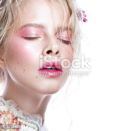 istock Beautiful blond fashion girl with flowers on neck and in 615723490