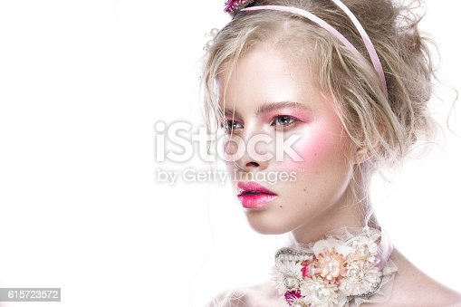 istock Beautiful blond fashion girl with flowers on neck and in 615723572