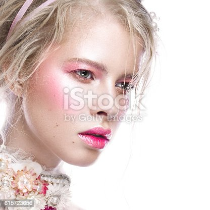 istock Beautiful blond fashion girl with flowers on neck and in 615723656