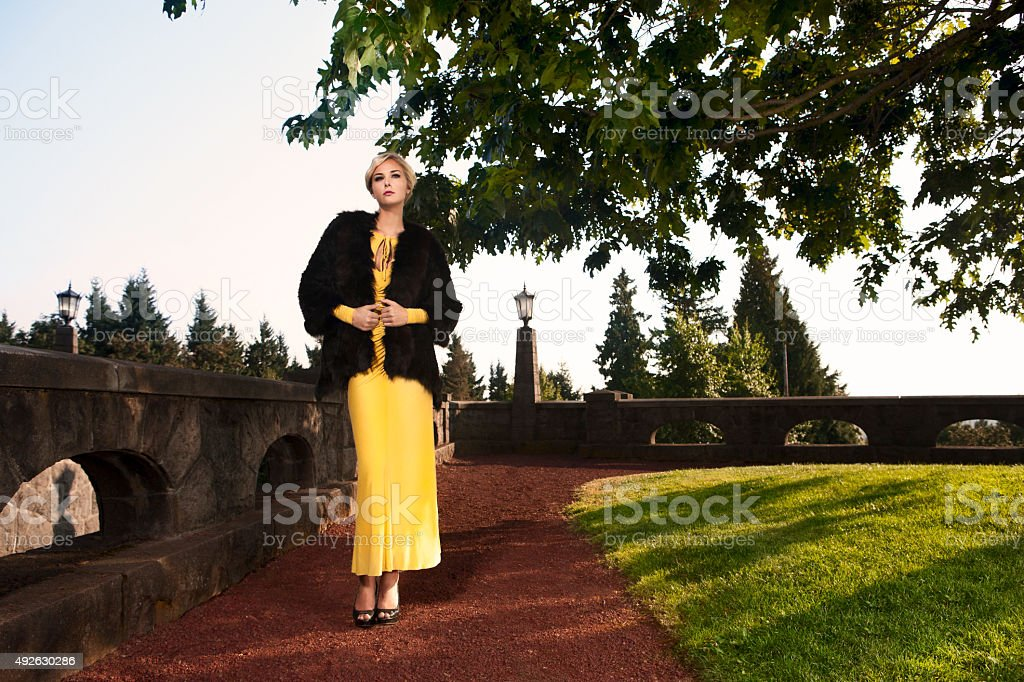Beautiful Blond Fashion Model in Mink on Estate Bluff, Copyspace stock photo