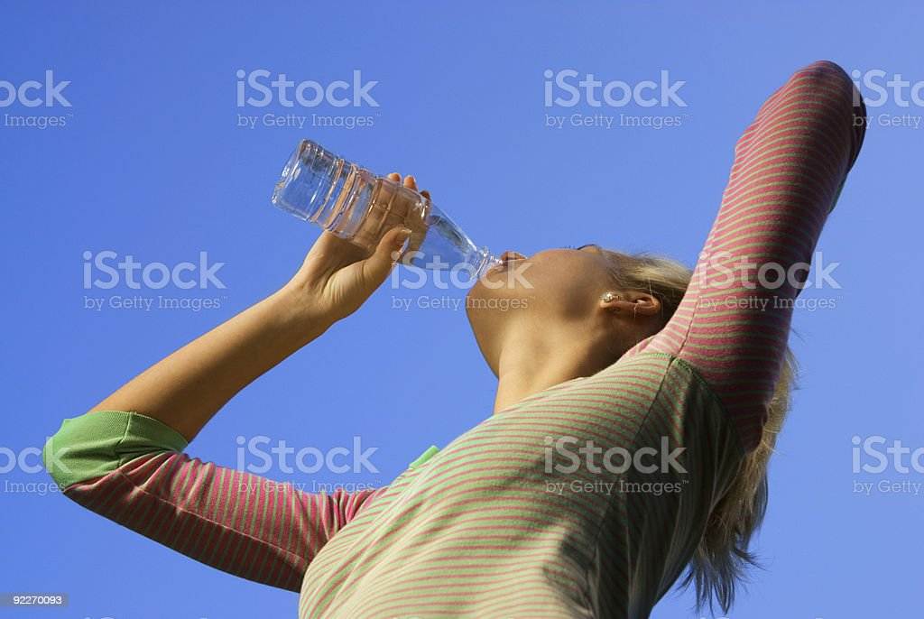 Beautiful blond girl dinking water royalty-free stock photo
