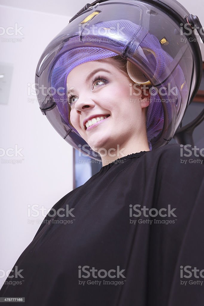 Beautiful blond girl hair curlers rollers hairdresser beauty salon royalty-free stock photo
