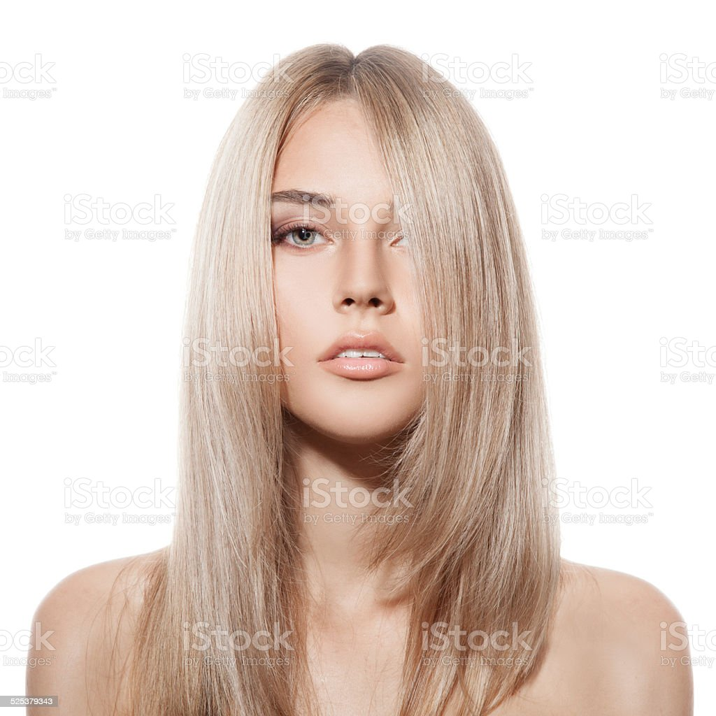 Beautiful Blond Girl. Healthy Long Hair. White Background stock photo