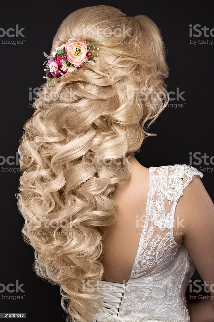 beautiful blond girl  in image of the bride with purple stock photo
