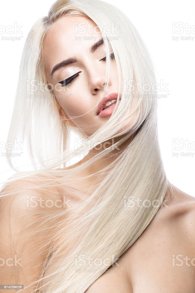 Beautiful blond girl in move with a perfectly smooth hair stock photo