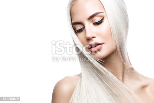 istock Beautiful blond girl in move with a perfectly smooth hair 614209606