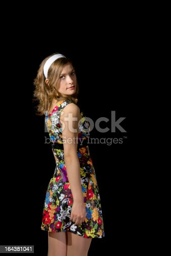 Beautiful blond girl in pinup style isolated on black background