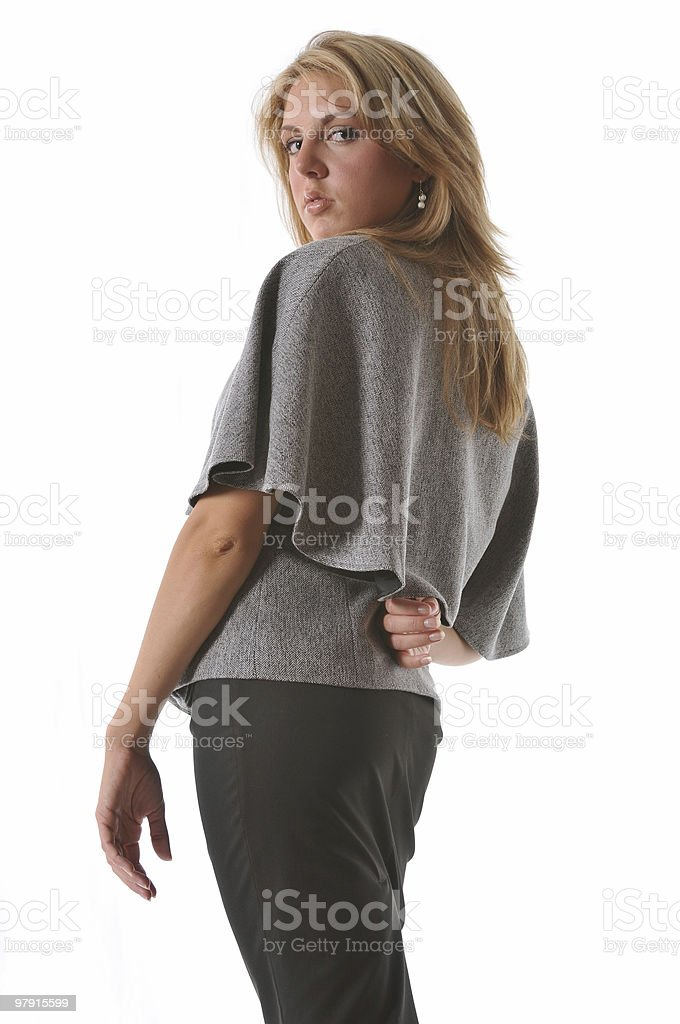 Beautiful blond girl looking over her shoulder royalty-free stock photo