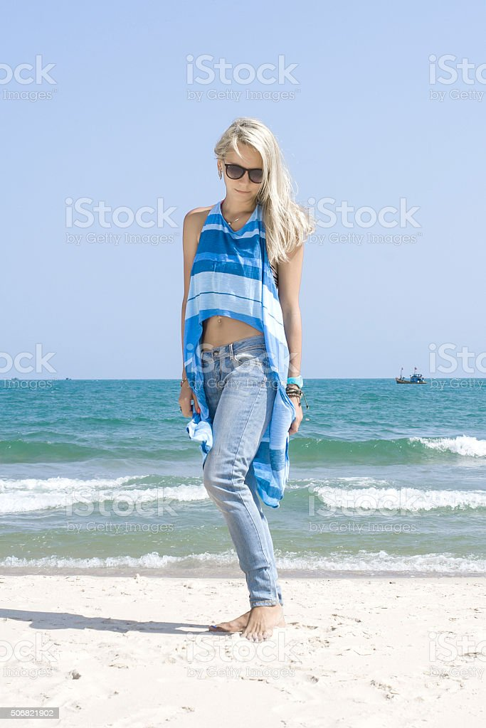 Beautiful Blond Girl On a Beach in Sunglasses stock photo
