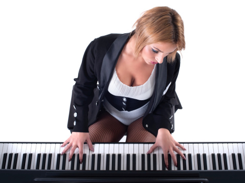 Beautiful blond girl playing piano