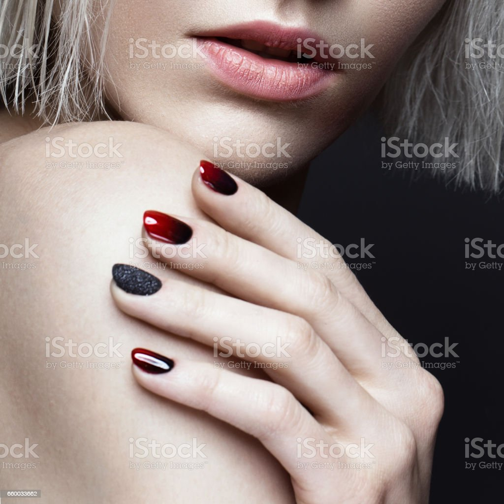 Beautiful blond girl with dark smokey makeup and art manicure design nails. beauty face. stock photo