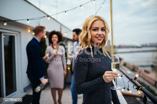 istock Beautiful blond girl with glass 1027859220