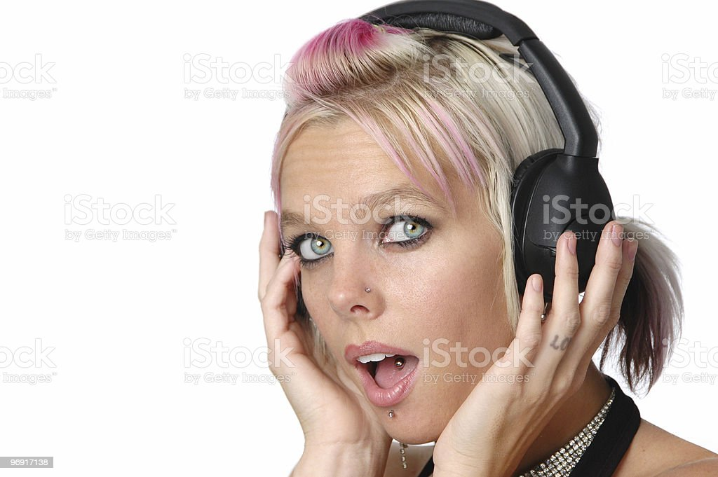 Beautiful blond listening to music royalty-free stock photo