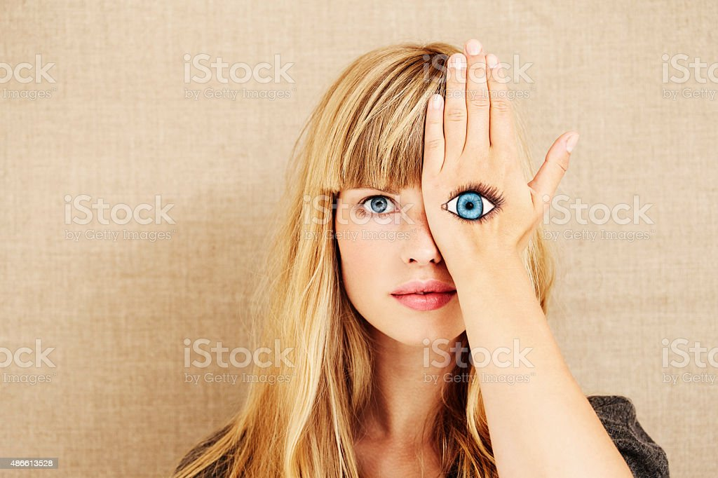 Beautiful blond with painted eye royalty-free stock photo
