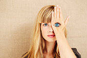 istock Beautiful blond with painted eye 486613528