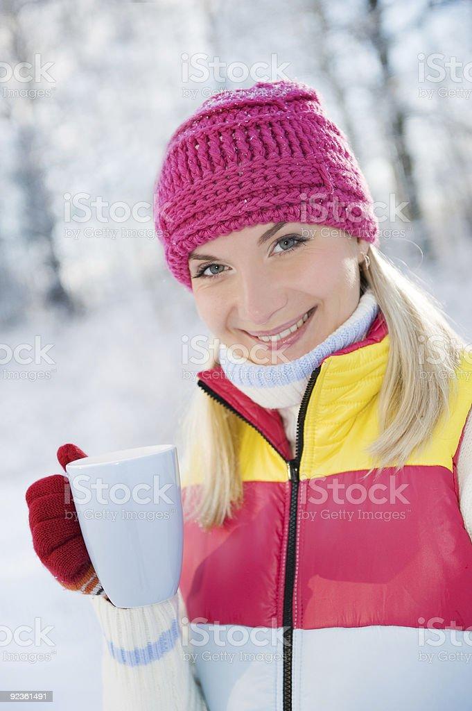 Beautiful blond woman drinking hot tea outdoors royalty-free stock photo