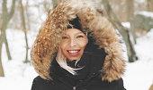 istock Beautiful blond woman in a winter parka 1130443896