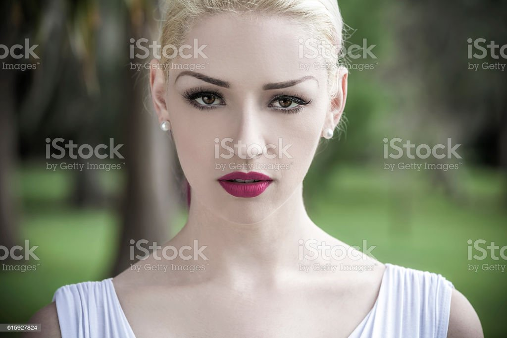 Beautiful Blond Woman in White Dress stock photo