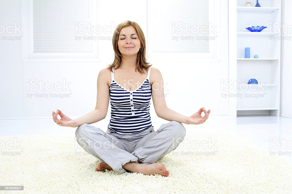 Beautiful blond woman relaxing at home with yoga. royalty-free stock photo