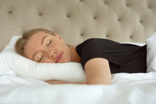 Beautiful blond woman sleeping in bed