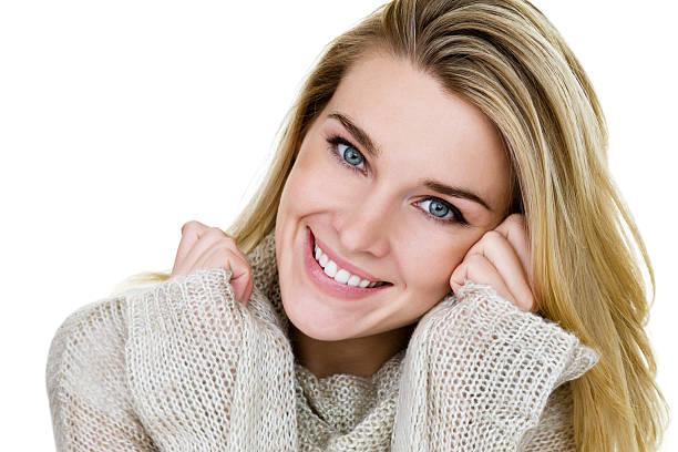 Beautiful Blond woman wearing a sweater stock photo