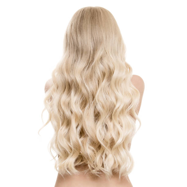 Beautiful Blond Woman With Long Wavy Hair. Back View. Isolated stock photo