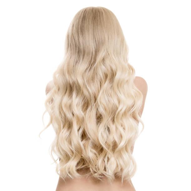 beautiful blond woman with long wavy hair. back view. isolated - frisuren für schulterlanges haar stock-fotos und bilder