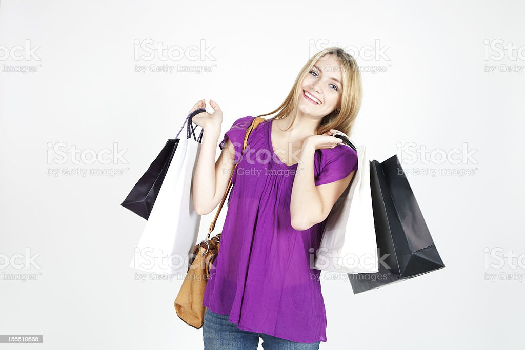 Beautiful blond woman with shopping bags royalty-free stock photo