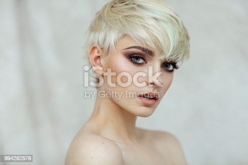 Fashion photo of beautiful woman with fashionable haircut