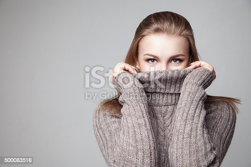 istock Beautiful blond young girl wears winter pullover 500063516
