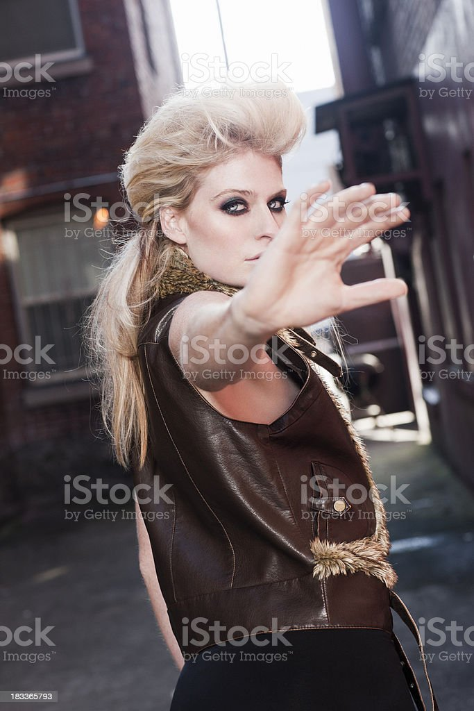 Beautiful Blond Young Woman as Fashion Model Blocking Camera stock photo