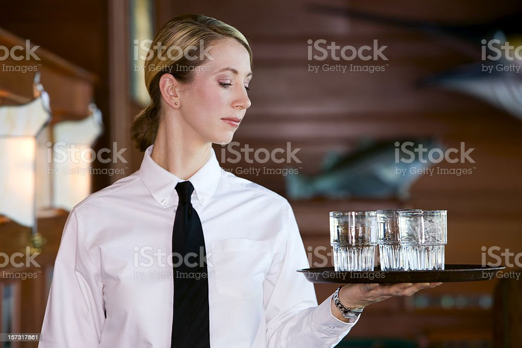 Beautiful Blond Young Woman as Server in Seafood Restaurant, Copyspace stock photo