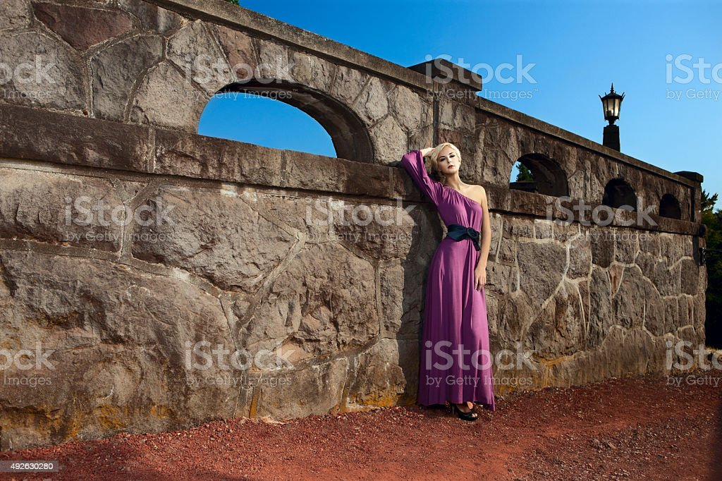 Beautiful Blond Young Woman Fashion Model in Long Dress stock photo