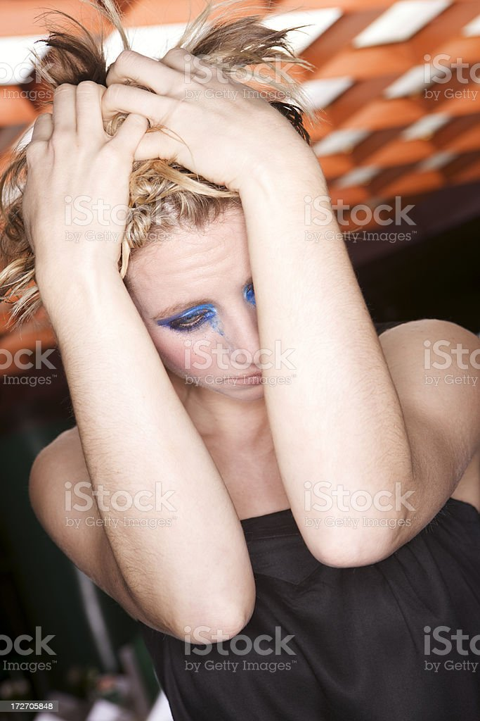 Beautiful Blond Young Woman, Head in Hands, Distressed stock photo