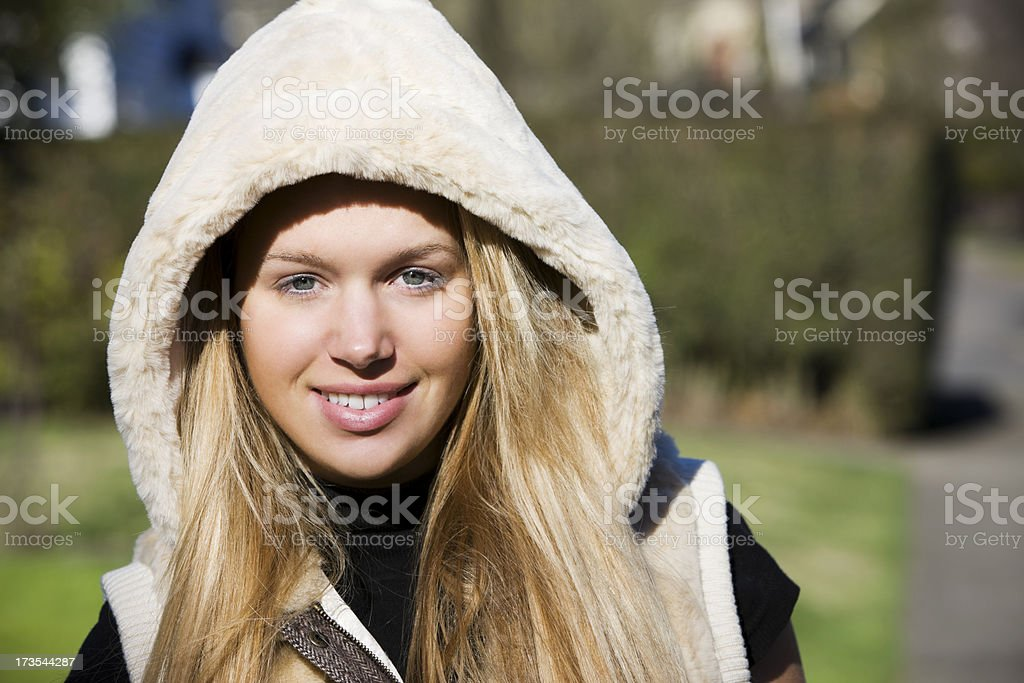 Beautiful Blond Young Woman Portrait Outside on Fall Sunny Day stock photo