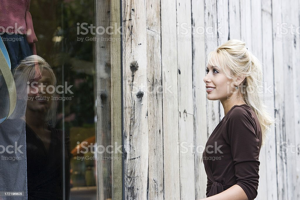 Beautiful Blond Young Woman Window Shopping Downtown, Copy Space royalty-free stock photo