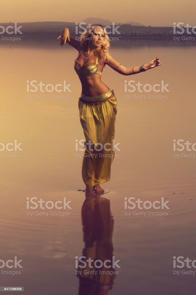 Beautiful blonde belly dancer woman stock photo