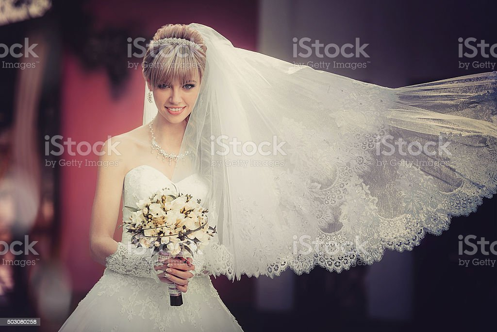 beautiful blonde bride with wedding bouquet in the hand stock photo