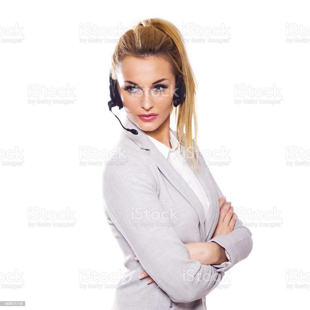 Beautiful blonde business woman with headset. Call center. royalty-free stock photo