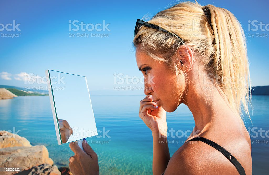 Beautiful blonde doing makeup royalty-free stock photo