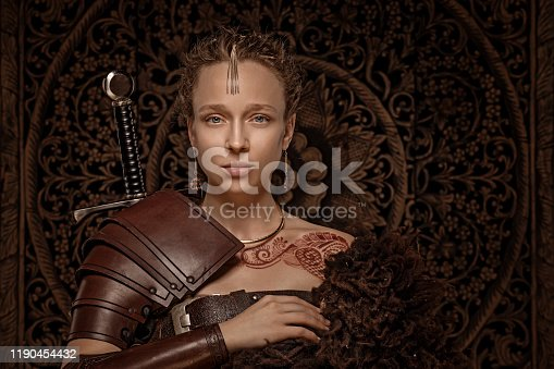 Beautiful blonde Ethnic Warrior Woman wearing mehndi pattern henna tattoo