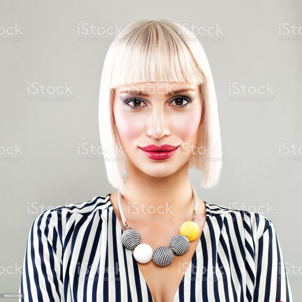 Beautiful Blonde Fashion Model Woman with Healthy Skin, Bob Hairstyle and Perfect Makeup stock photo
